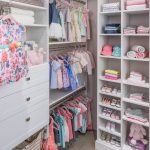 Girls walk in closet with clothing on racks and shelves