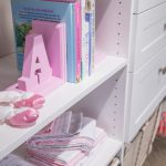 Close up of girls closet with shelves, drawers and racks