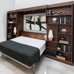 Pulled out murphy bed with books on shelves