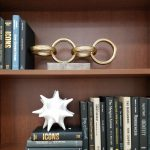 Books and bookends on shelves of murphy bed