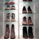 Glass and wood shelves with shoes placed on top