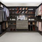 Walk-in Closet Filled with Clothes and Other Articles