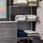 Inspired Closets Shelves with Clothing on Them