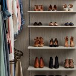 Closet with focus on shoes and handbags on shelves