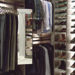 Inspired closets closet with shelves, clothing racks and a mirror
