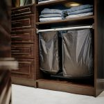 Inspired Closets closet with space for clothes hamper