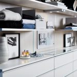 Modern White Floating Shelves and Drawers for Walk-In Closet