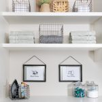 Custom floor mounted boutique laundry room storage easy shelving storage