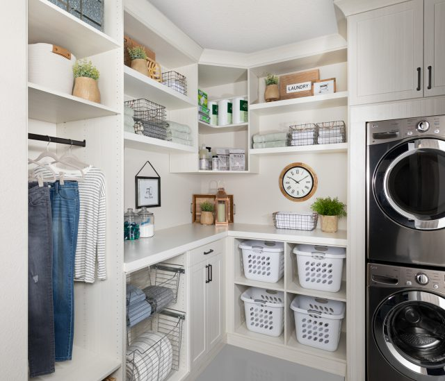 Custom floor mounted boutique laundry room storage