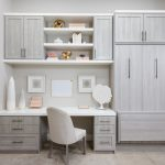 Custom home office storage with closed Murphy bed and shelving and cabinet storage
