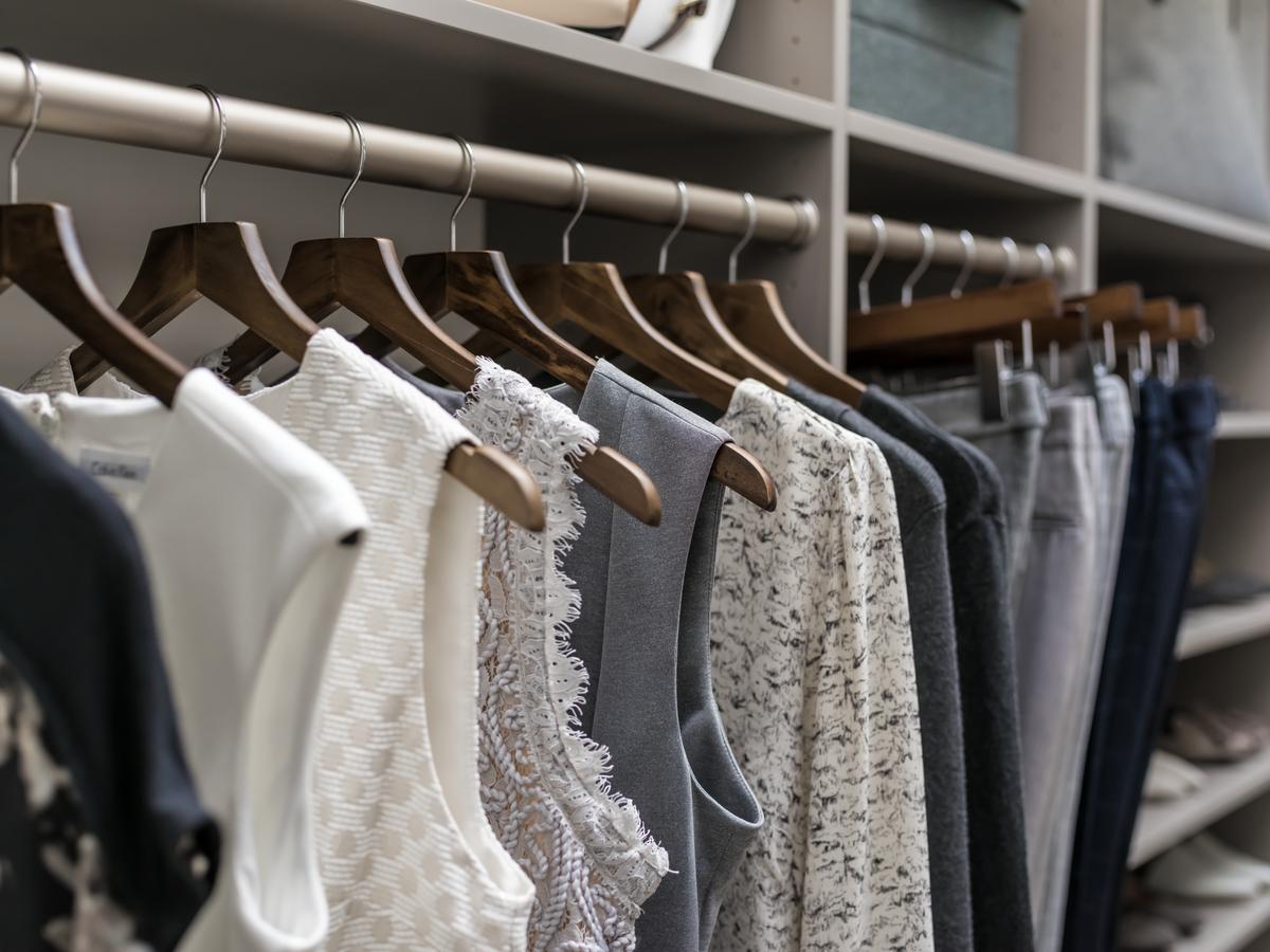 Women's hanging cloths in an Inspired Closets custom closet